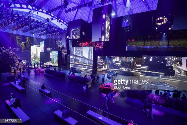 Attendees walk through the Daimler AG exhibition hall on day two of the IAA Frankfurt Motor Show in Frankfurt, Germany, on Wednesday, Sept. 11, 2019....