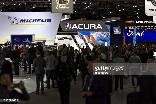 Attendees walk through the exhibit floor of the 2019 North American International Auto Show in Detroit, Michigan, U.S., on Monday, Jan. 14, 2019....