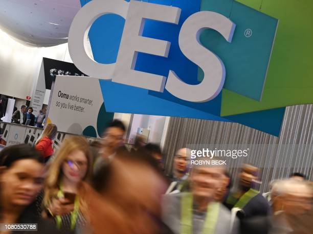 Attendees walk through the hall at the Sands Expo Convention Center during CES 2019 consumer electronics show on January 10 2019 in Las Vegas Nevada