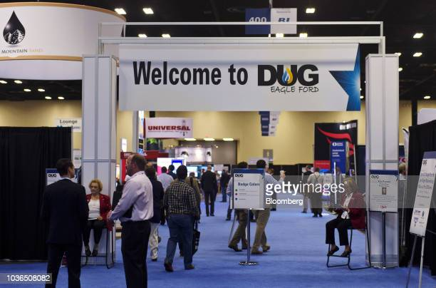 Attendees walk through the Hart Energy DUG Eagle Ford Shale conference in San Antonio Texas US on Thursday Sept 20 2018 The conference focuses on the...