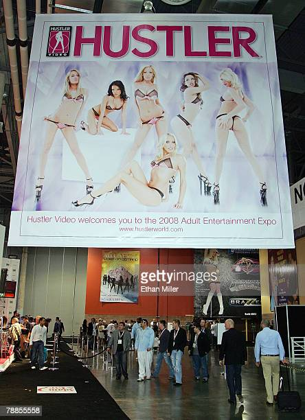 Attendees walk under a banner for Hustler at the 2008 AVN Adult Entertainment Expo and the Sands Expo and Convention Center January 9 2008 in Las...
