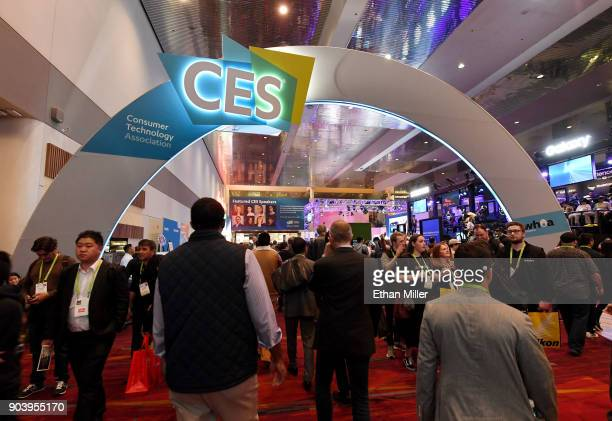 Attendees walk under a CES sign in the lobby during CES 2018 at the Las Vegas Convention Center on January 11 2018 in Las Vegas Nevada CES the...