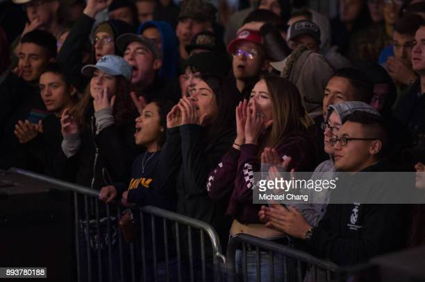 Attendees watch a musical performance during Base*FEST Powered by USAA on December 15 2017 at Naval Air Station Pensacola Florida