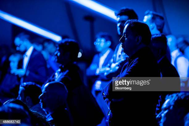Attendees watch a presentation by Satya Nadella chief executive officer of Microsoft Corp not pictured during a keynote address at the DreamForce...