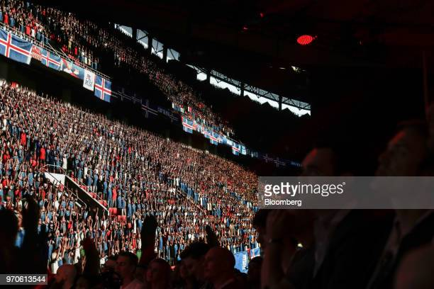 Attendees watch a preview for the FIFA 19 soccer video game during an Electronic Arts Inc Play event ahead of the E3 Electronic Entertainment Expo in...