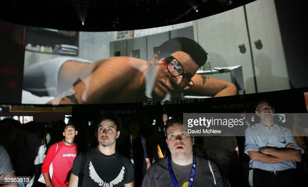 Attendees watch as a video game character is shot in the eye in the EA game, The Godfather, on a 360 degree screen at the 11th annual Electronic...