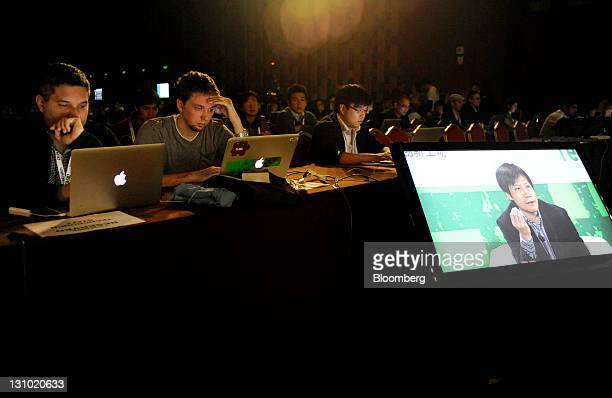 Attendees watch as Lei Jun cofounder of Xiaomi Technology Co displayed on a screen speaks during the TechCrunch Disrupt Beijing conference in Beijing...
