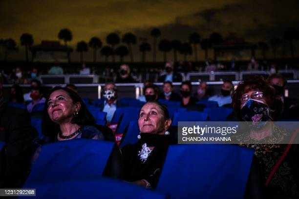 """Attendees watch """"La Bohème"""" on stage for the first mainstream opera performance in the US since the beginning of the Covid-19 pandemic, organized by..."""