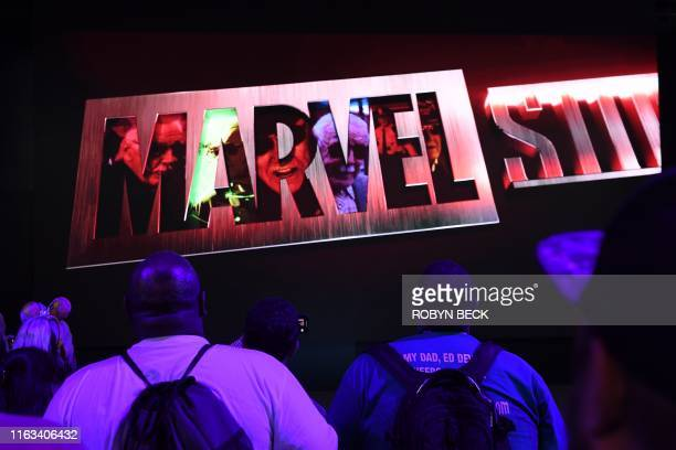 """Attendees watch Marvel Studios visual at the Disney+ booth at the D23 Expo, billed as the """"largest Disney fan event in the world,"""" August 23, 2019 at..."""
