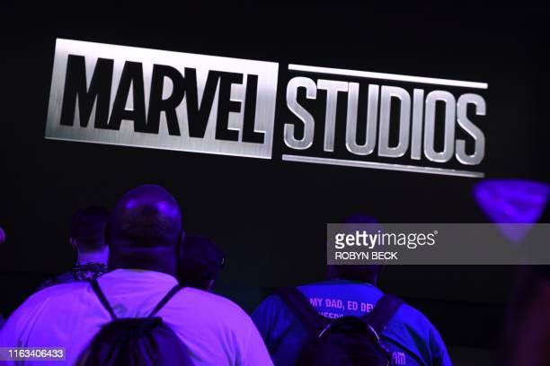 Attendees watch Marvel Studios visual at the Disney booth at the D23 Expo billed as the largest Disney fan event in the world August 23 2019 at the...