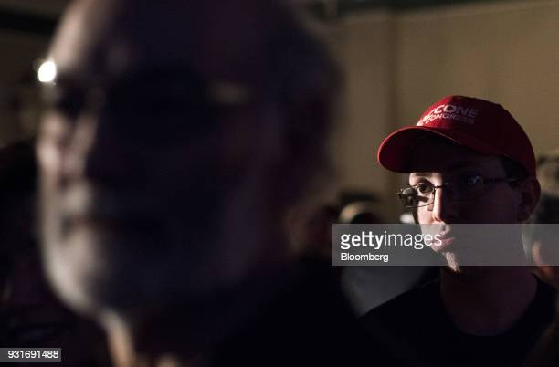 Attendees watch polling results during an election night rally with Rick Saccone Republican candidate for the US House of Representatives not...