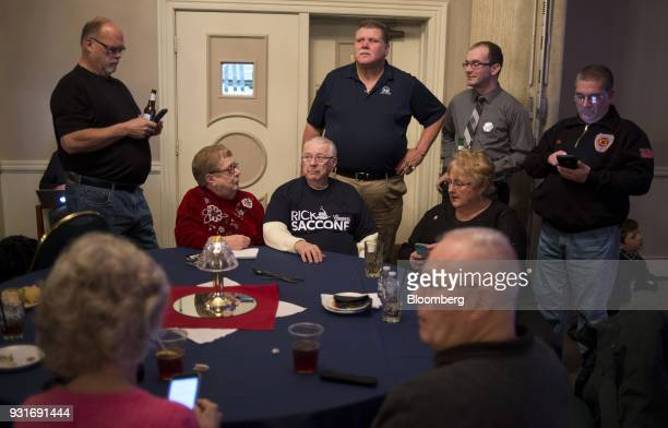 Attendees watch polling results on TV during an election night rally with Rick Saccone Republican candidate for the US House of Representatives not...