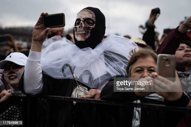 Attendees watch the Dead parade on Paseo de la Reforma Avenue on November 2 2019 in Mexico City Mexico Observants celebrate the Day of the Dead in...