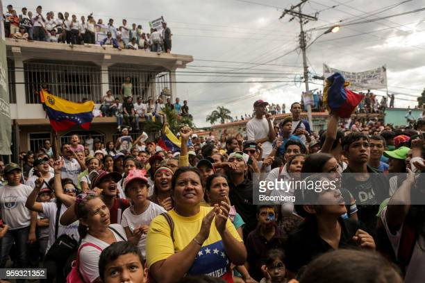 Attendees wave flags and cheer during the closing campaign rally for Evangelical pastor Javier Bertucci presidential candidate for the Esperanza Por...