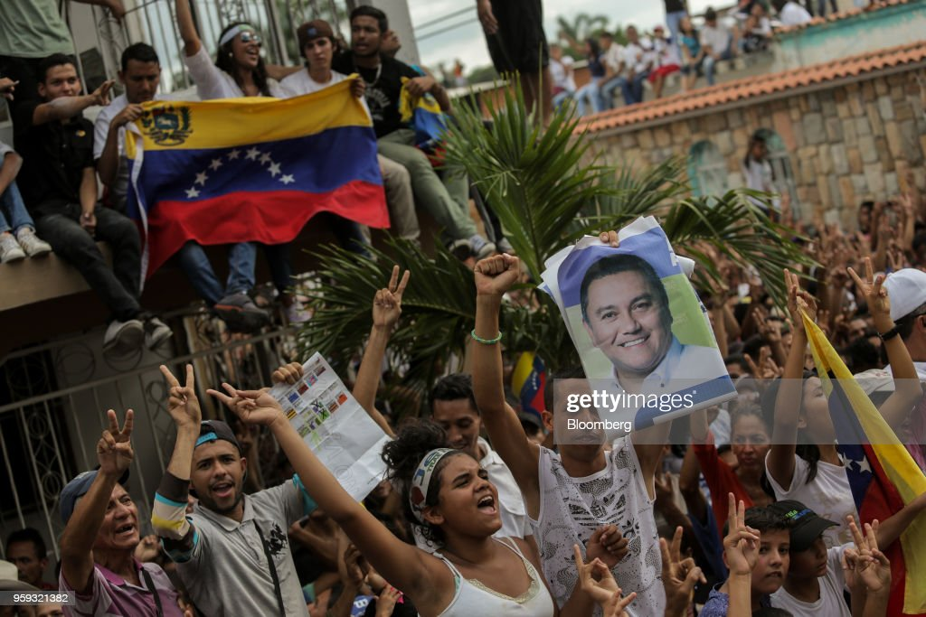 Attendees wave flags and cheer during the closing campaign rally for Evangelical pastor Javier Bertucci, presidential candidate for the Esperanza Por El Cambio (EEC) Party, in Valencia, Carabobo state, on Wednesday, May 16, 2018. Venezuelans head to the polls on May 20, as foreign leaders call for a suspension and the country's main opposition alliance shun the elections. Photographer: Manaure Quintero/Bloomberg via Getty Images
