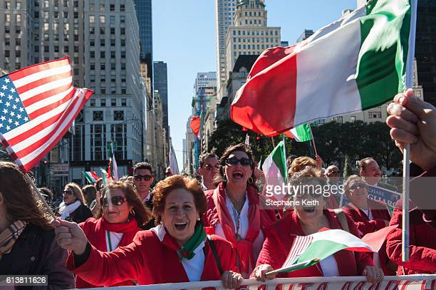 Attendees wave flags at the annual Columbus Day Parade on October 10 2016 in New York City This is the 72nd Columbus Day Parade held in New York City