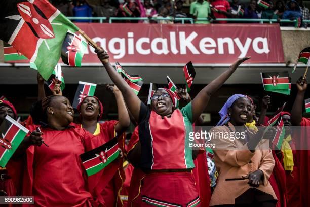Attendees wave Kenyan national flags during the independence celebrations on Jamhuri Day at Kasarani stadium in Nairobi Kenya on Tuesday Dec 12 2017...