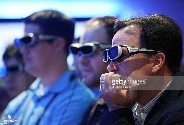 CES attendees wear 3D glasses as they watch a 3D television in the Panasonic booth at the 2010 International Consumer Electronics Show at the Las...