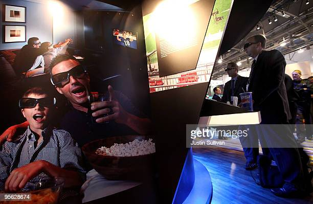 CES attendees wear 3D glasses as they watch a 3D television in the Sony booth at the 2010 International Consumer Electronics Show at the Las Vegas...