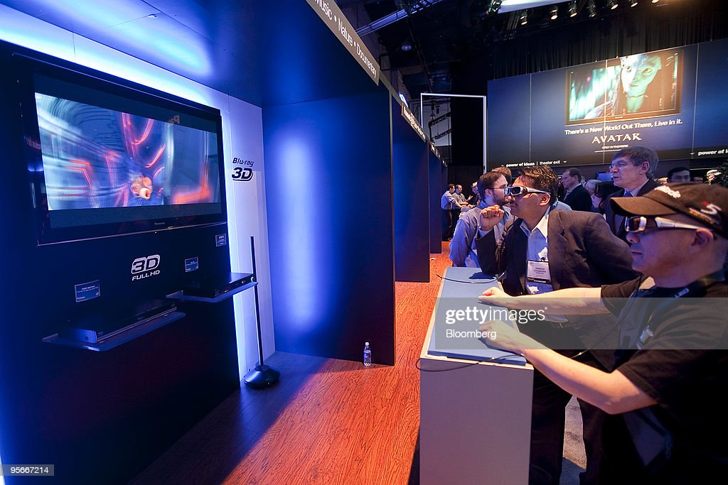 Attendees wear 3-D glasses while looking at a Panasonic Corp. Viera 3-D television during the 2010 International Consumer Electronics Show (CES) in Las Vegas, Nevada, U.S., on Friday, Jan. 8, 2010. 20,000 new technologies will debut at CES, which runs through Jan. 11 and is expected to see at least 113,000 attendees and 2,500 exhibitors, the Consumer Electronics Association said. Photographer: Daniel Acker/Bloomberg via Getty Images
