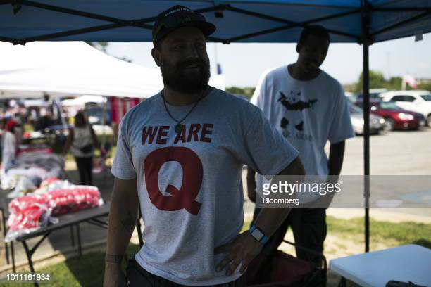 Attendees wear a tshirt with the words We Are Q before the start of a rally with US President Donald Trump in Lewis Center Ohio US on Saturday Aug 4...