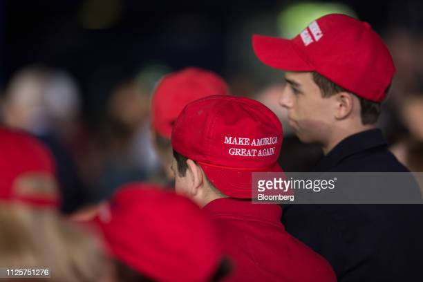 Attendees wear Make America Great Again hats during an event with US President Donald Trump not pictured and the Venezuelan American community in...