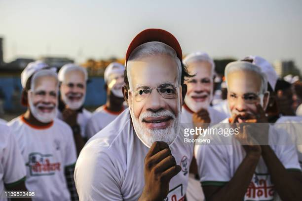 Attendees wear masks of India's Prime Minister Narendra Modi ahead of a rally in Mumbai India on Friday April 26 2019 Modis Bharatiya Janata Party...