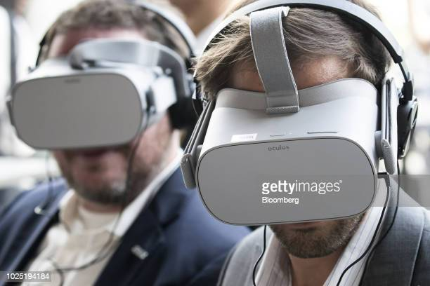 Attendees wear virtual reality headsets during an Uber Technologies Inc's demonstration at the Uber Elevated Asia Pacific Expo event in Tokyo Japan...