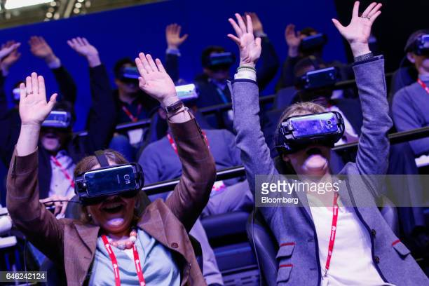 Attendees, wearing Samsung Gear headsets, experience a virtual reality roller coaster ride on the Samsung Electronics Co. Stand on the second day of...