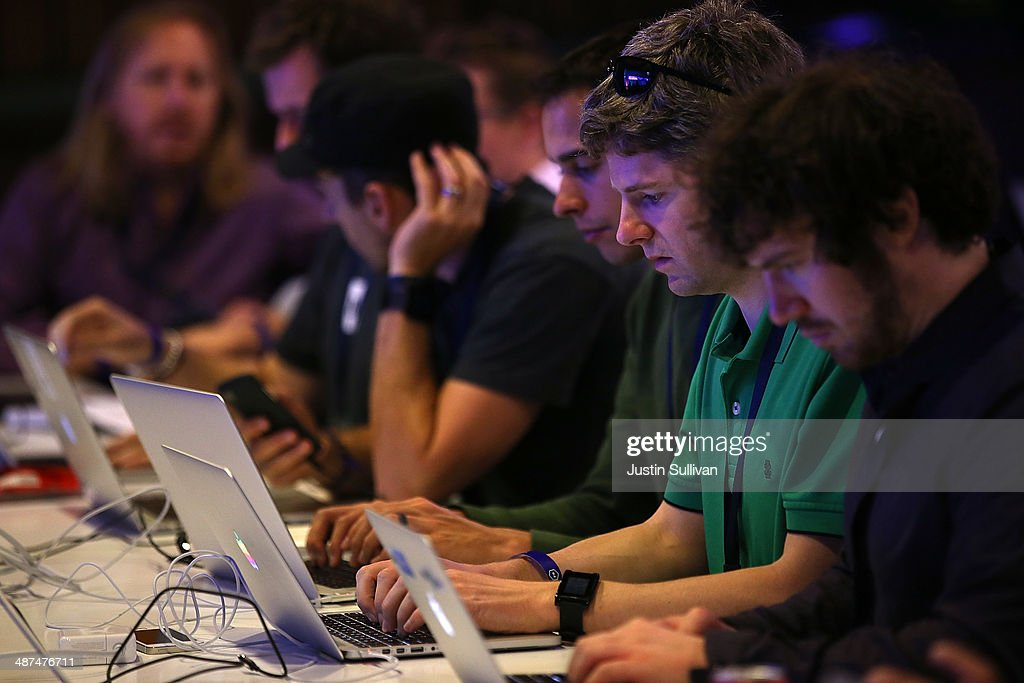 Attendees work on computers at the Facebook f8 conference on April 30, 2014 in San Francisco, California. Facebook CEO Mark Zuckerberg kicked off the annual one-day F8 developers conference.
