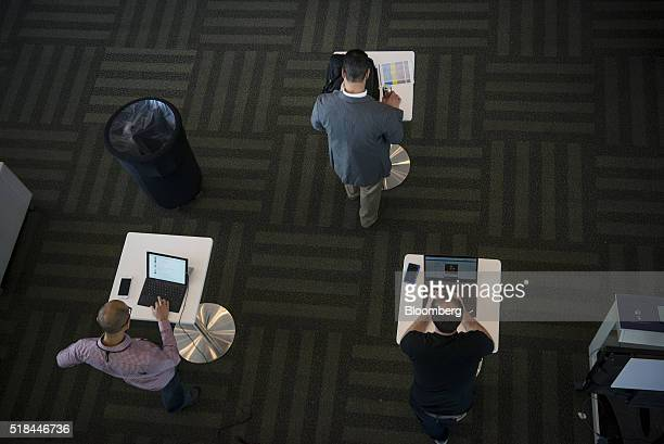 Attendees work on laptop computers at the Microsoft Developers Build Conference in San Francisco California US on Thursday March 31 2016 Microsoft...