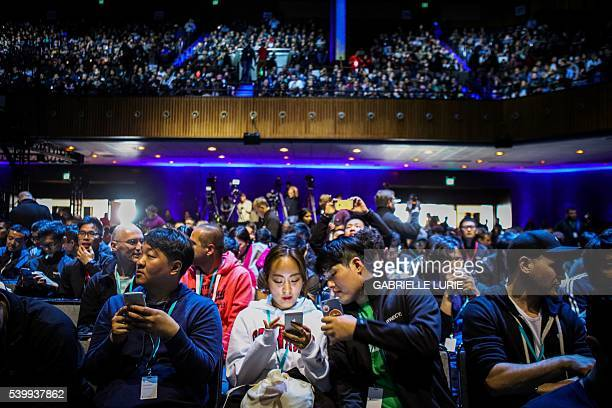 Attendees work on their devices ahead of Apple's annual Worldwide Developers Conference in San Francisco California on June 13 2016 / AFP / GABRIELLE...