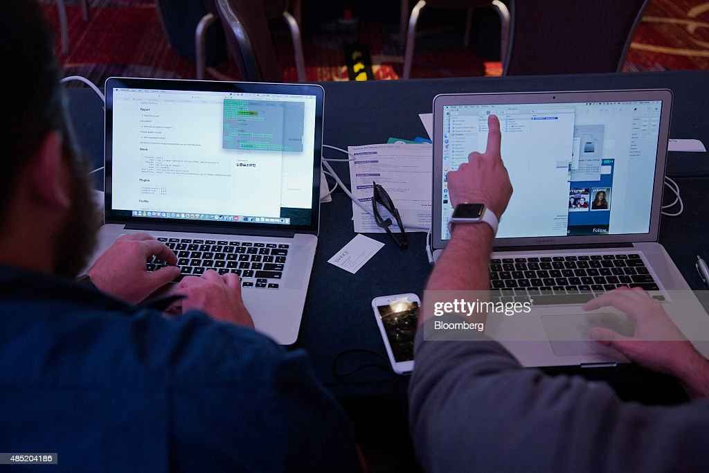 Attendees working on Apple Inc. laptop computers participate in the Yahoo! Inc. Mobile Developer Conference Hackathon in New York, U.S., on Tuesday, Aug. 25, 2015. The Hackathon is an opportunity for mobile developers to come together and hack around the Yahoo! Inc. Mobile Developer Suite. Photographer: Victor J. Blue/Bloomberg via Getty Images