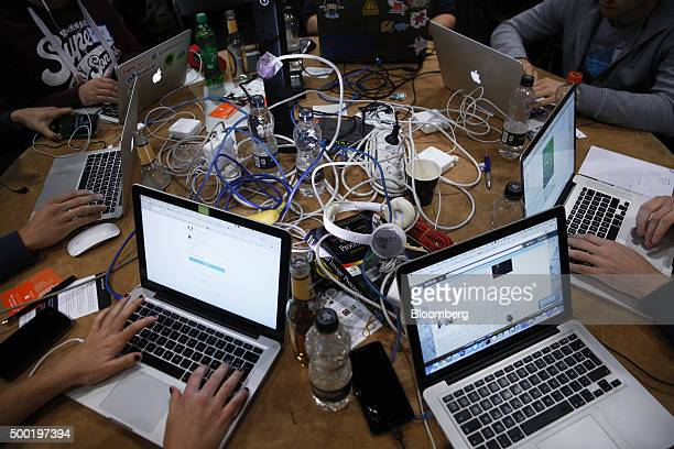 Attendees working on Apple Inc laptop computers participate in the TechCrunch Disrupt London 2015 Hackathon in London UK on Saturday Dec 5 2015...