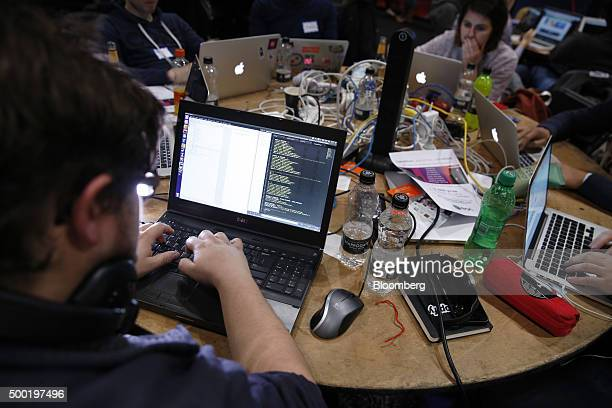 Attendees working on laptop computers participate in the TechCrunch Disrupt London 2015 Hackathon in London UK on Saturday Dec 5 2015 Disrupt is an...