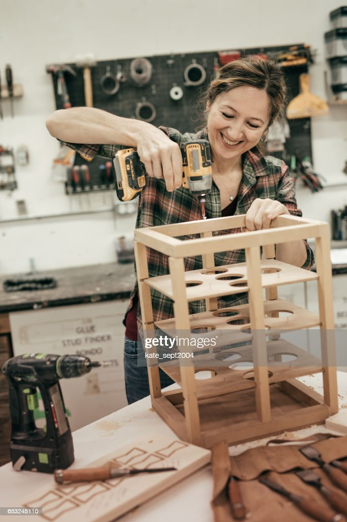 Attending woodworking workshop : Stock Photo