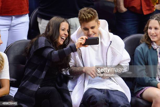 XXX attends an NBA playoff game between the Oklahoma City Thunder and the Los Angeles Clippers at Staples Center on May 11 2014 in Los Angeles...