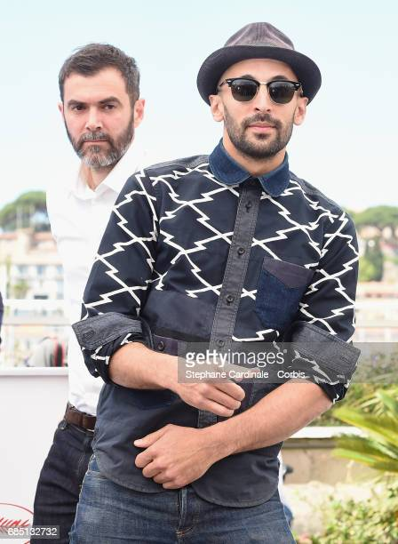 JR attends the 'Faces Places ' photocall during the 70th annual Cannes Film Festival at Palais des Festivals on May 19 2017 in Cannes France