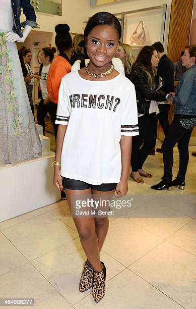 E attends the French Connection #CantHelpMySelfie launch party at French Connection Regent Street store on April 15 2014 in London England