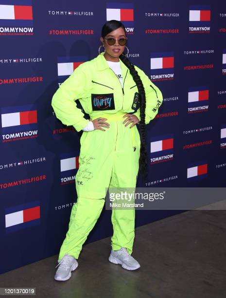 R attends the TommyNow Step Repeat during London Fashion Week February 2020 at the Tate Modern on February 16 2020 in London England