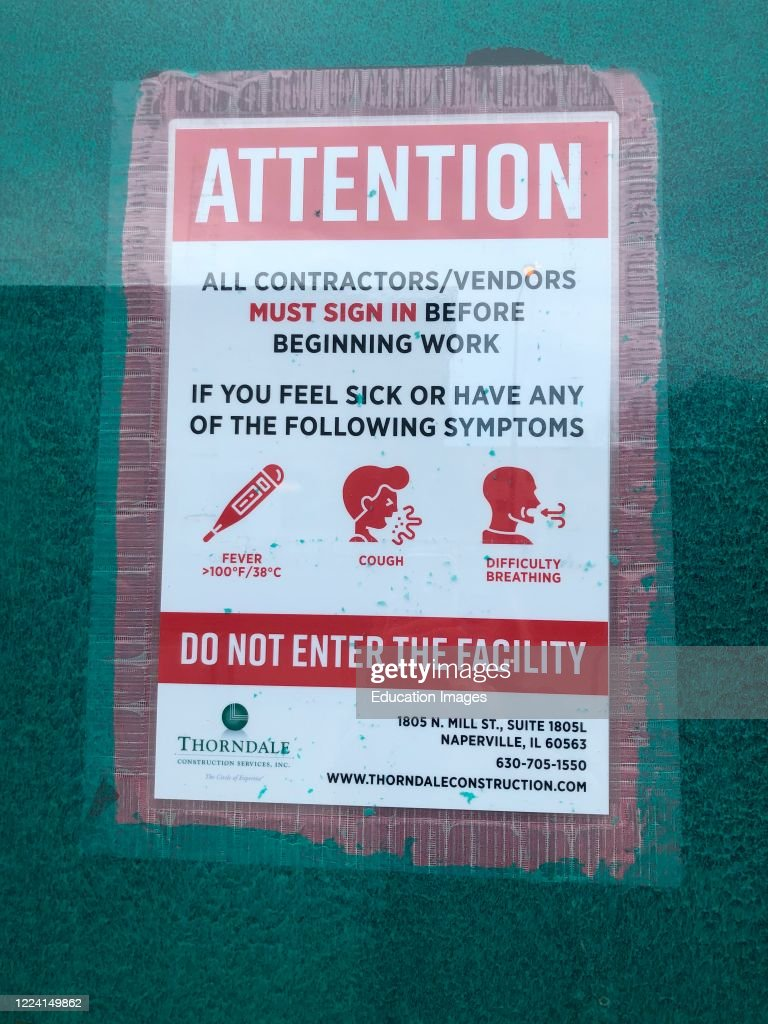 Attention all Contractors or vendors must sign in, warning of symptoms for Coronavirus, do not enter, Chicago, Illinois : News Photo