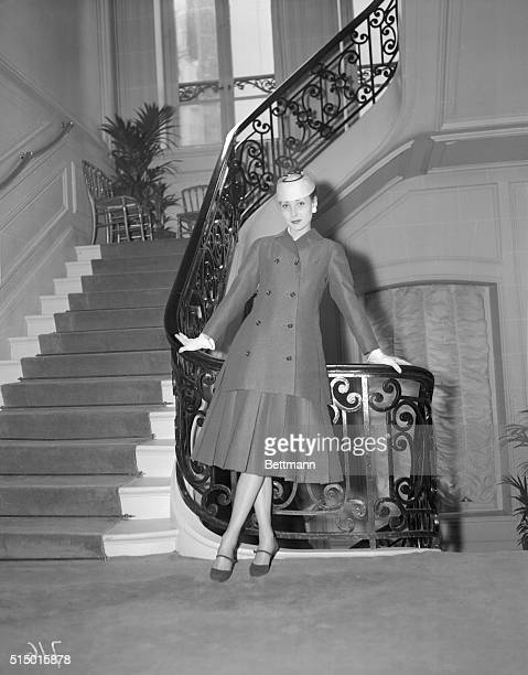 Woman's Page Editor Paris France From the current Paris fashions a Christian Dior suit is a trend setter in his spring show Of gray flannel the 'A'...