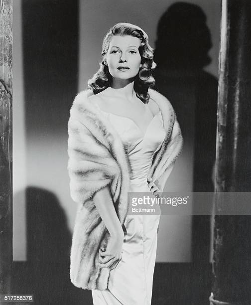 Attention Women's Page Editor Hollywood California Rita Hayworth whom you'll be seeing in Columbia Pictures' Fire Down Below complements an unadorned...