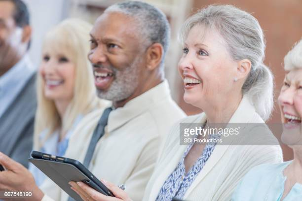 attentive active senior attend continuing education class - working seniors stock pictures, royalty-free photos & images