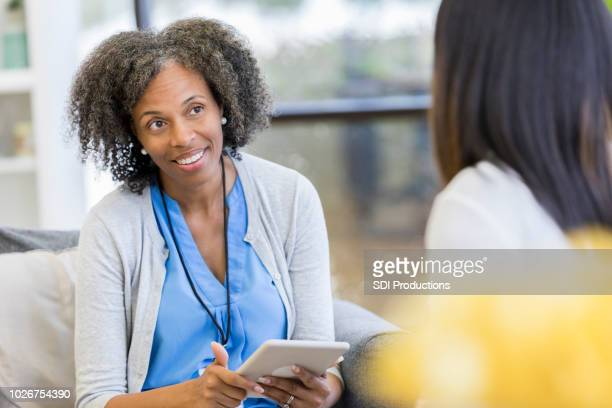 attentive counselor listens to patient - psychologist stock photos and pictures
