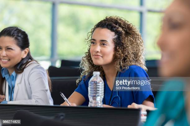 attentive healthcare professional attending seminar - participant stock pictures, royalty-free photos & images