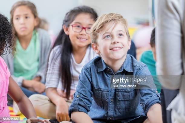 Attentive little boy enjoys story time after school