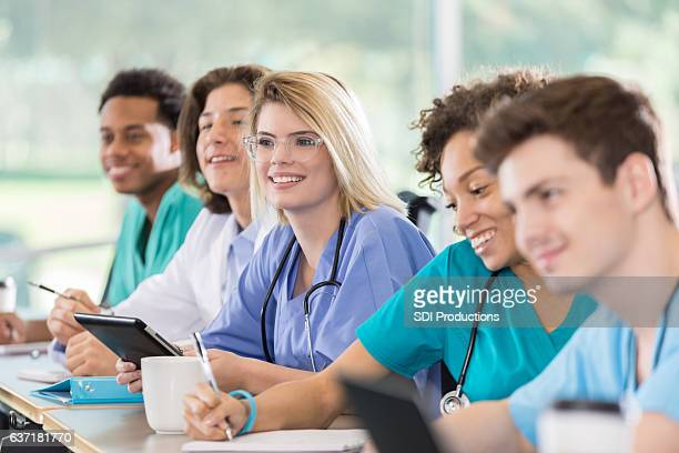 Attentive medical students in class