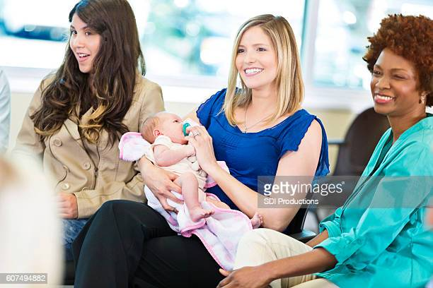 Attentive new mother participates in meeting