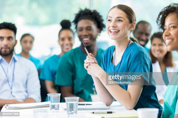 attentive nursing students in class - medical student stock pictures, royalty-free photos & images